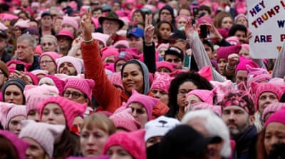Tens of thousands of women and allies protest in Washington, DC, after Trump takes office [Shannon Stapleton/Reuters]