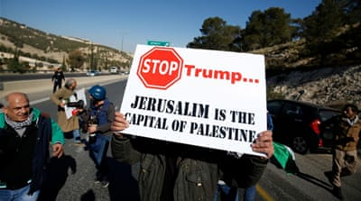 A Palestinian demonstrator protests against Trump's promise to relocate the US embassy to Jerusalem [Mohamad Torokman/Reuters]