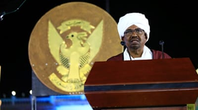Sudan's president Omar al-Bashir waves at traditional performers after he addressed the nation during the country's 61st independence day, on December 31 [Reuters]