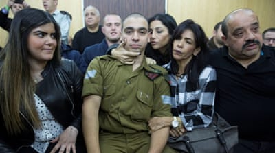 Israeli soldier Elor Azaria, who is charged with manslaughter by the Israeli military, sits to hear his verdict in a military court in Tel Aviv [Reuters]