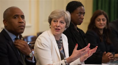 Theresa May held a meeting Tuesday at 10 Downing Street to discuss the findings of the race review [Daniel Leal-Olivas/AFP]