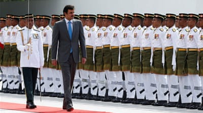 Why is Qatar's emir visiting Malaysia?
