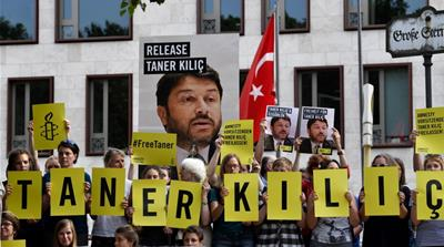 Call for Amnesty Turkey head's release as trial resumes
