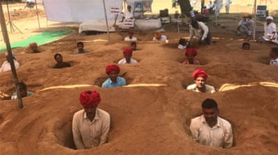 Rajasthan farmers sit neck-deep to protest land deal