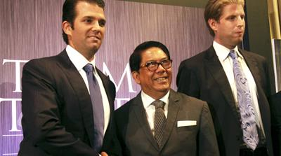 Donald Trump Jr and Eric Trump pose with local developer Jose Antonio during a press conference on the launching of Manila's Trump Tower project worth $150m on June 26, 2012 [AP Photo/Pat Roque]