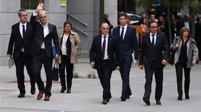 Catalonia: Judge jails eight removed ministers