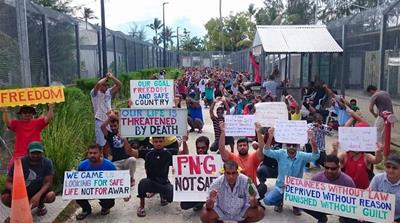 Refugees protest at the Manus Island prison camp in Papua New Guinea [Refugee Action Coalition via AP]