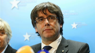 Former Catalan leader turns self in to Belgian police