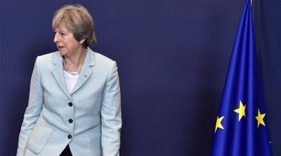 May loses Brexit vote in parliament before EU summit
