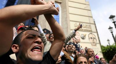 Journalists in Cairo protest restrictions on the press and demand the release of detained journalists [Reuters]