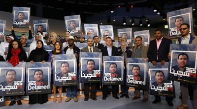 Al Jazeera's Mahmoud Hussein has been imprisoned for more than one year without due process [Al Jazeera]