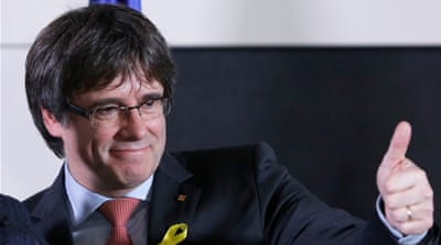Puigdemont, facing charges, to be Catalan president