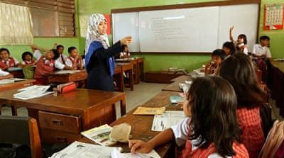 A teacher engages her pupils during a 5th grade social studies class at their school in Jakarta, Indonesia [Ed Wray/Getty Images]
