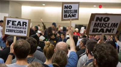 Four US states have filed suits against Trump's travel ban, alleging religious discrimination [EPA]