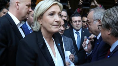 Le Pen was offered a white shawl to cover her hair before the meeting [Aziz Taher/Reuters]