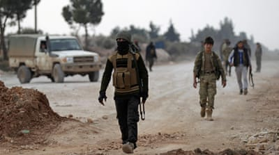 Free Syrian Army fighters patrol near al-Bab earlier this month [Khalil Ashawi/Reuters]