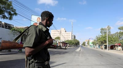 File: A Somali policeman stands guard during a security lock down in Mogadishu [Feisal Omar/Reuters]