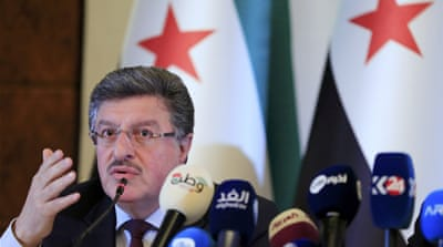 Opposition negotiator Hariri called on the Syrian government to stop playing the 'terrorism card' [AP]