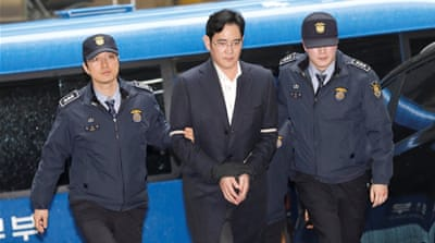 Samsung chief Lee arrives at the office of the independent counsel team in Seoul [Kim Hong-ji/Reuters]