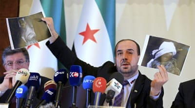 Opposition negotiator Hariri called on the Syrian government to stop playing the 'terrorism card'  [Pierre Albouy/Reuters]