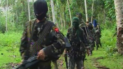 Abu Sayyaf rebels are seen in the southern Philippines in this 2009 video grab [Reuters]
