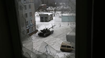 Shelling by the army reportedly killed two civilians in Donetsk [Alexander Ermochenko/AP]