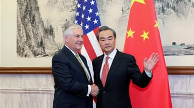 Tillerson held talks with Wang Yi, China's foreign minister, on Saturday [Reuters]