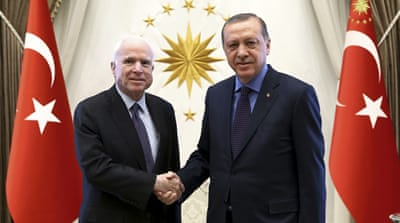 President Recep Tayyip Erdogan, right, and Senator John McCain shake hands prior to a meeting in February [Kayhan Ozer/AP]