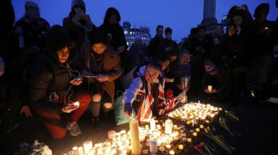 People lit candles in memory of the four victims killed on Westminster Bridge and outside parliament [Darren Staples/Reuters]