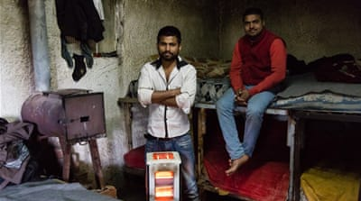 Migrant workers Gulfam and Kaleem, in their house on the edge of Poullakida [Will Horner/Al Jazeera]