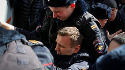 Police officers detain Navalny during a rally in central Moscow [Maxim Shemetov/Reuters]