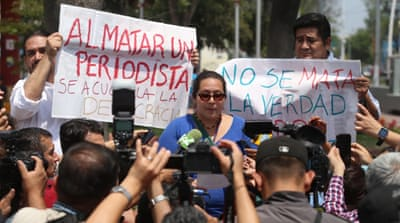 Mexican journalists protest after three of their colleagues were killed in March [EPA]