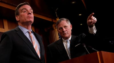 Committee Chairman Richard Burr and Vice Chairman Mark Warner discuss their probe at Capitol Hill [Aaron P Bernstein/Reuters]