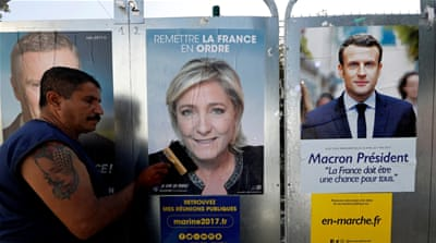 Far-right leader Le Pen, left, and centrist Macron, right, advance to French presidential runoff after major opponents concede defeat [Reuters]