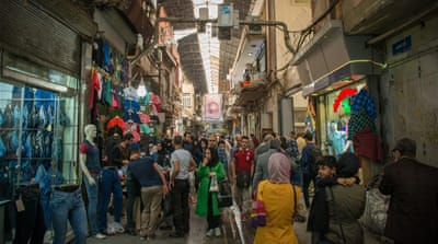 Shoppers stroll among the booths of Tehran's Grand Bazaar [Wojtek Arciszewski/Al Jazeera]