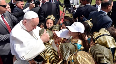 Pope Francis is greeted by children in Cairo on April 29 [Reuters]