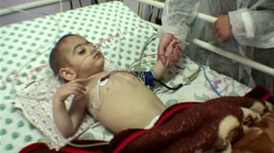 Firaz Mazloom was born in Gaza with two holes in his heart and needs surgery, but his parents' requests to cross into Israel for access to appropriate care are being denied. [Screengrab/Al Jazeera]