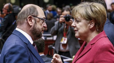 SDP chairman Martin Schulz, left, will take on the German Chancellor Angela Merkel, right, in September's federal elections [Yves Herman/Reuters]