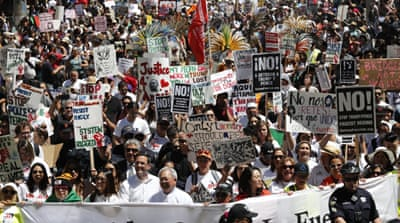 Protesters gathered in cities across the US for International Workers' Day [Bria Webb/Reuters]