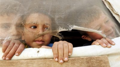 Syrian refugee children look out from their tent in Saadnayel in Lebanon's Bekaa Valley [Mohamed Azakir/Reuters]