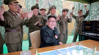 Kim Jong-un reacts to a test launch of ground-to-ground medium-range missile in this undated photo [KCNA via Reuters]
