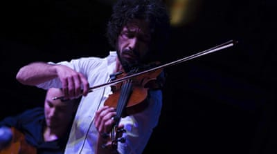 A Syrian violinist's journey 'from brutality to hope'