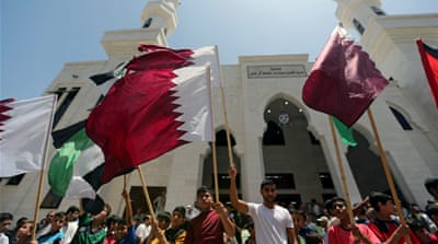 Palestinians take part in a rally in support of Qatar in the southern Gaza Strip on Friday [Ibraheem Abu Mustafa/Reuters]