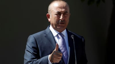 Cavusoglu said he might go to Saudi Arabia after concluding his Kuwait visit [Yiannis Kourtoglou/Reuters]