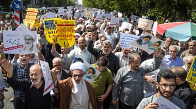 Iranian protesters chant slogans against the ruling Al Saud family of Saudi Arabia, the US and Israel during a rally after weekly Friday prayer in Tehran [AP]