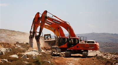 Palestinian landowners push to halt settlement building