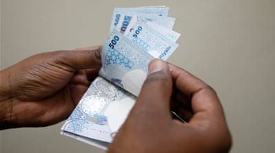 The riyal is officially fixed at 3.64 to the dollar by an Emiri decree since 2001 [Reuters]