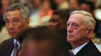 James Mattis, right, and Singapore's Prime Minister Lee Hsien Loong listen to a speech at the International Institute for Strategic Studies on Saturday [Wallace Woon/EPA]