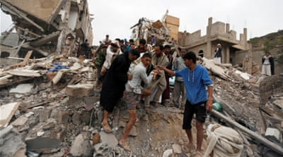 People search under rubble of a house destroyed by a Saudi-led air raid in Sanaa [Khaled Abdullah/Reuters]