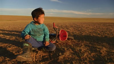 Mongolia: Training with a child jockey